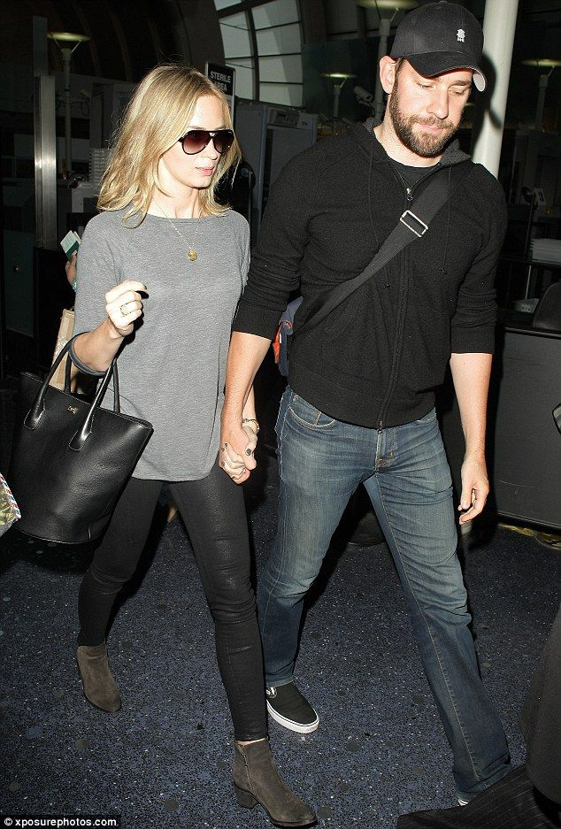 In step: Emily Blunt and husband John Krasinski exited LAX on Thursday wearing laid-back but put-together ensembles, lovingly holding each others hands