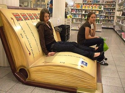At De Slegte bookstore in the Hague, Netherlands. I would love a sofa like this!