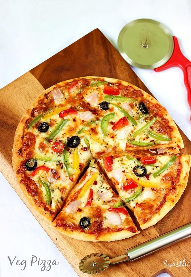 Pizza recipe with video & step by step photos. Learn to make the best veg pizza at home, includes pizza sauce and making pizza dough