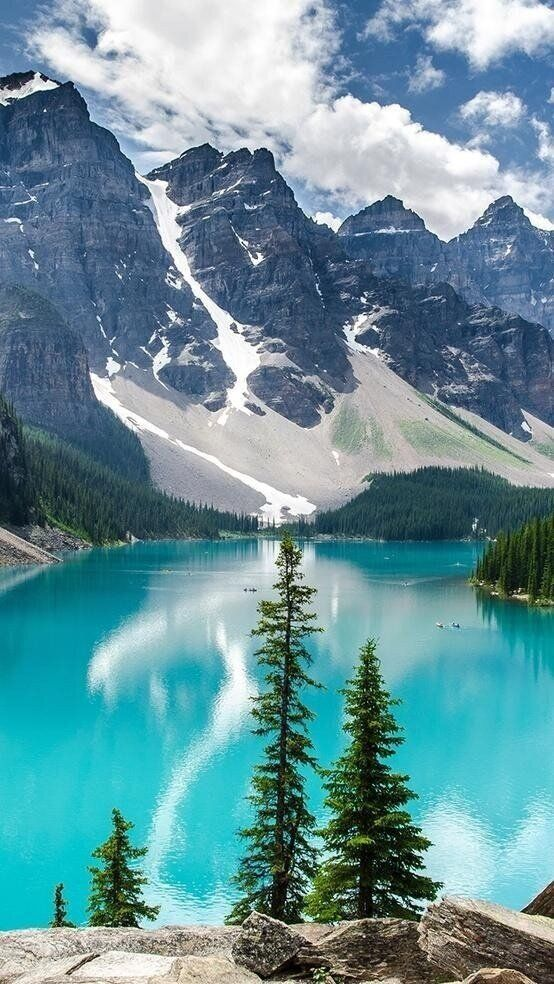 nature, nothing more perfect as mountain with a blue lake beneath, with the touch of some trees!
