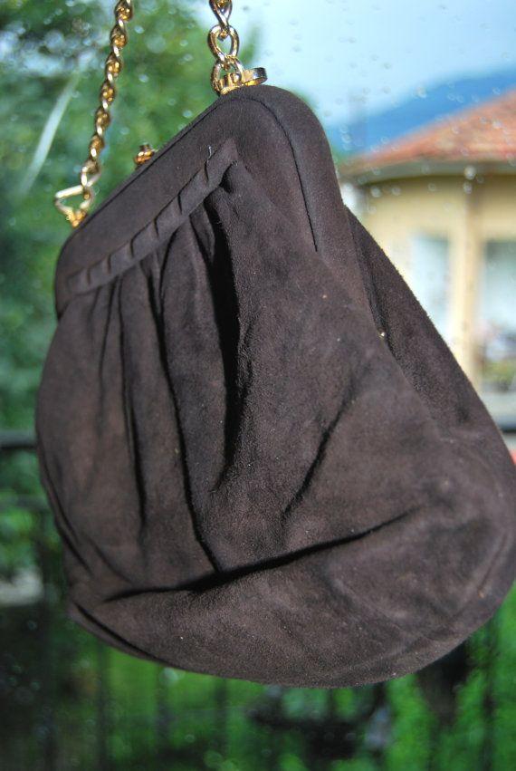 https://www.etsy.com/listing/196343341/vintage-handbag-dark-brown-gold-chain?ref=listing-0