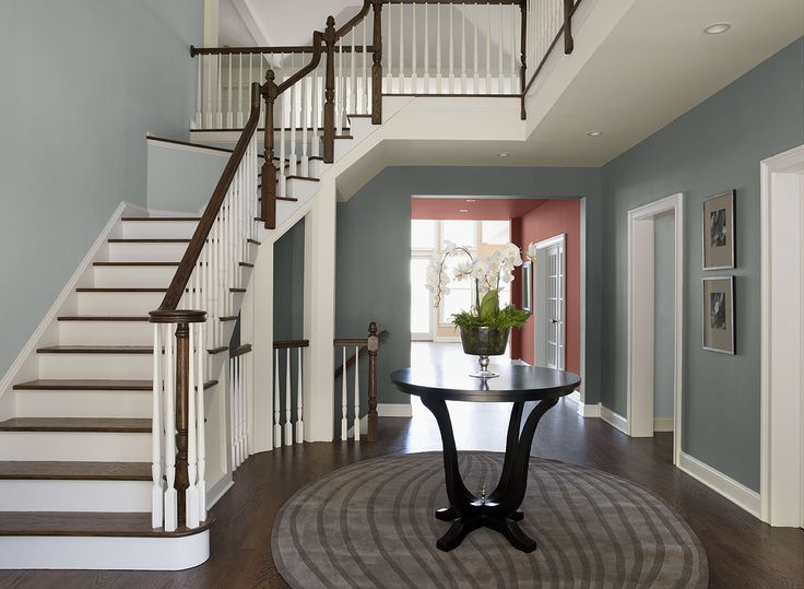 Benjamin Moore Paint Colors - Blue Entryway Ideas - Beguiling Blue Entry - Paint Color Schemes . . . . . Two blues give this entry a double dose of charm. . . . . . Walls (in entryway under stairs) - Cloudy Sky (2122-30); Stairway Walls - Smoke (2122-40); Hallway Wall (walls in hallway beyond entry way) - Coral Bronze (1298).