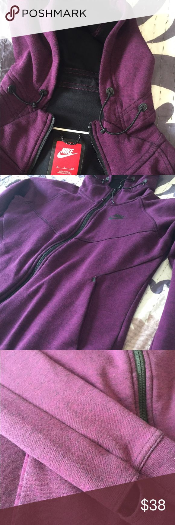 Nike heathered purple zip up hoodie S Beautiful and rare Nike hooded zip up with thumb holes in size small. EUC! As shown in the last picture, there looks like there is a tiny little snag on the back side of one of the sleeves. Nike Tops Sweatshirts & Hoodies