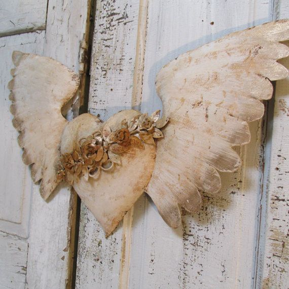 White rusted angel wings with heart metal wall hanging French Santos styles with roses and vines embellishment home decor anita spero