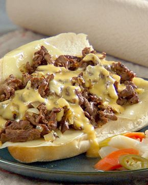 Philly Cheese Steaks - Martha Stewart Recipes I would not do the cheese sauce part. And I have seen them shake some water onto the meat as it cooks on the griddle in cheese steak shops in Philly.  The hard part will be finding a good roll.