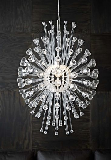 The new STOCKHOLM collection: A chandelier design inspired by dew drops in a spider web.