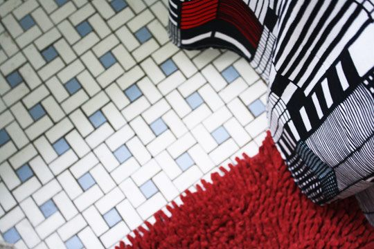 Vintage Bathroom Tile Floor in blue and white with black grout