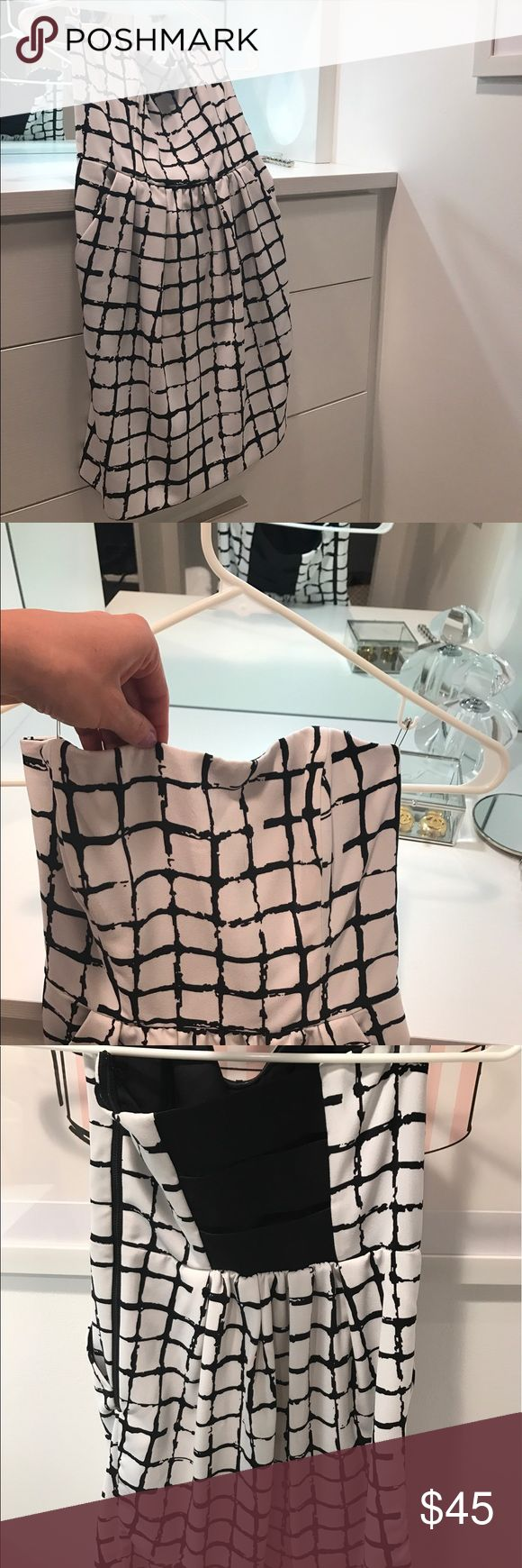 Black and white patterned mini dress. Worn 2x Rachel Roy Black and white patterned mini dress. Worn 2x and dry cleaned after each wear. Dress is shorter, but has a classy look. Front pockets for a comfortable wear. RACHEL Rachel Roy Dresses Mini