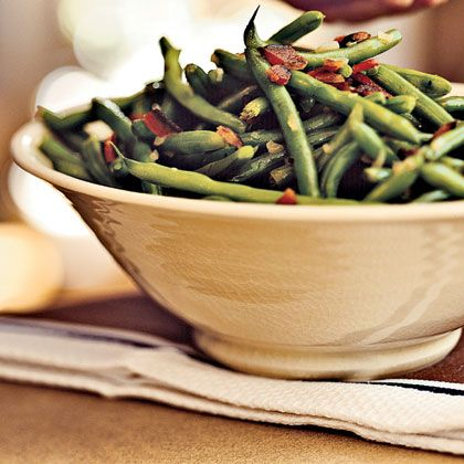 Checkout this simple Green Beans with Bacon Recipe at LaaLoosh.com. This low calorie side dish is a great way to get your veggie servings in while trying to stay on track with your weight watchers points.