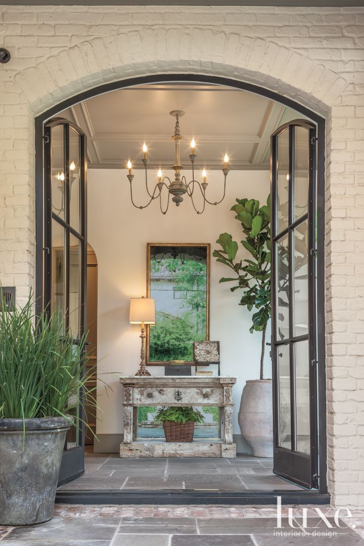 Home Entryway With Steel French Doors, Consol Table Chandelier Coffered  Ceilings. LUXE Magazine: Bayou Dreams: Home Redesign Inspired By Louisiana  Style