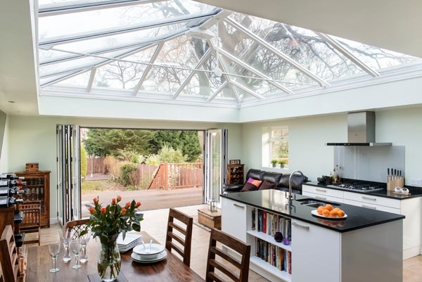 Combining a dining area with a kitchen is the perfect open plan living design and it is wonderfully light in an orangery