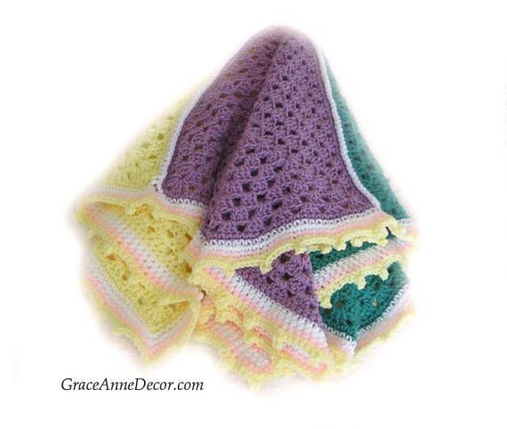 Baby Blanket Crochet Decrative Fun Whimsical Four Granny Square Yellow White Pink Green Handmade Perfect Shower Gift Home Decor Baby Nursery... This precious Baby Blanket is fun and Whimsical and perfect for decor in the baby's nursery or to use as a Baby Shower Gift, Photo Op and with a stroller or car seat. For a boy or girl. It is made with soft yarn in a four large granny squares with yellow, white, purple and green.