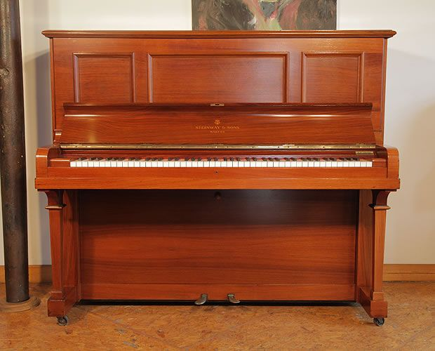 A 1913, Steinway Vertegrand Upright Piano For Sale with a Rosewood Case at Besbrode Pianos. Piano has an eighty-eight note keyboard and two pedals.