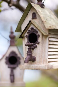 Hanging Birdhouse with faucet stoop.  Similar to one of ours with the keys and license plate roof. Cute idea.