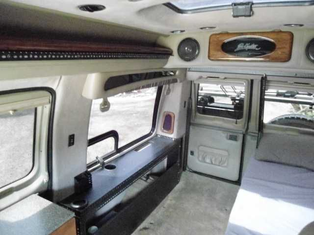 2004 Used Ford Econoline Class B in California CA.Recreational Vehicle, rv, 2004 Ford Econoline , 2004 FORD E 250. 112K MILES, AUTOMATIC, V8 5.4L, GAS, COLD AIR INTAKE, PERFORMANCE PROGRAMMER, BAJA LIFT KIT, ALUMNESS BUMPERS AND RUNNING BOARDS, 5,000 LB WARREN WENCH, AIR HORN, SPORTS MOBILE EQUIPMENT TOOLBOX, CUSTOM WHEELS AND TIRES, BLACKED OUT TINTED WINDOWS. INTERIOR: CUSTOM LEATHER INTERIOR BY EL KAPITAN VAN CONVERSIONS OUT OF HUNTINGTON BEACH, INCLUDES 4 CAPTAIN'S CHAIRS, TWO ARE…