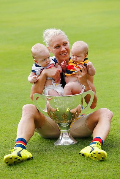 Erin Phillips Photos Photos - Erin Phillips of the Crows celebrates with her twins Blake and Brooklyn during the AFL Women's Grand Final between the Brisbane Lions and the Adelaide Crows on March 25, 2017 in Gold Coast, Australia. - AFL Women's Grand Final - Brisbane v Adelaide