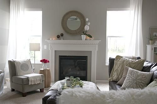 Gorgeous gray & chocolate brown living room with gray walls, fireplace ... not sure if i can put my brown furniture in a grey living room.... thoughts?