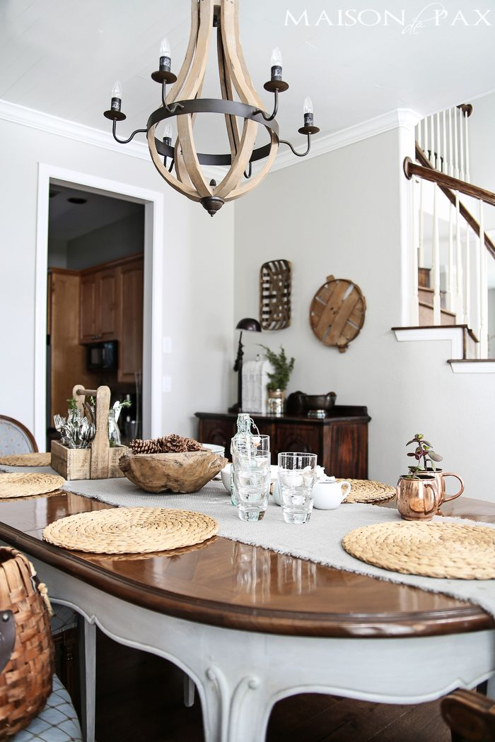 wine barrel chandelier provides a casual yet elegant look in this french country dining room | maisondepax.com