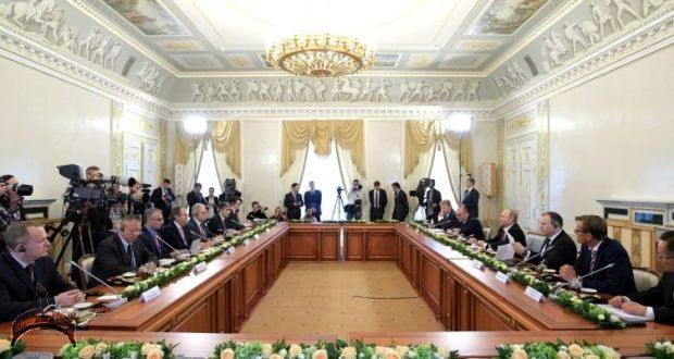 Russian President Vladimir Putin meets with the heads of Russian and foreign news agencies in St. Pe...