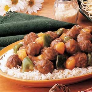 Tangy Sweet-and-Sour Meatballs Recipe -A tangy sauce, combine with green pepper and pineapple, tranforms Ruther's pre-made meatballs into a delightful main dish served over rice.