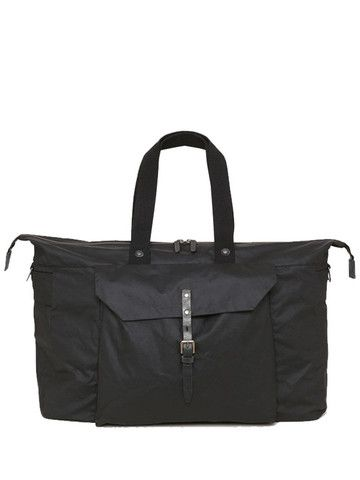 Ally Capellino Freddie Waxed Cotton Holdall: Perfectly sized to fit the flight allowance for carry on luggage, this large waxed cotton travel bag tmakes the ideal weekend bag. Featuring a generous front pocket, heavy bridle leather strap and buckle fastening, detachable webbing cross-body strap, and multiple inside pockets.