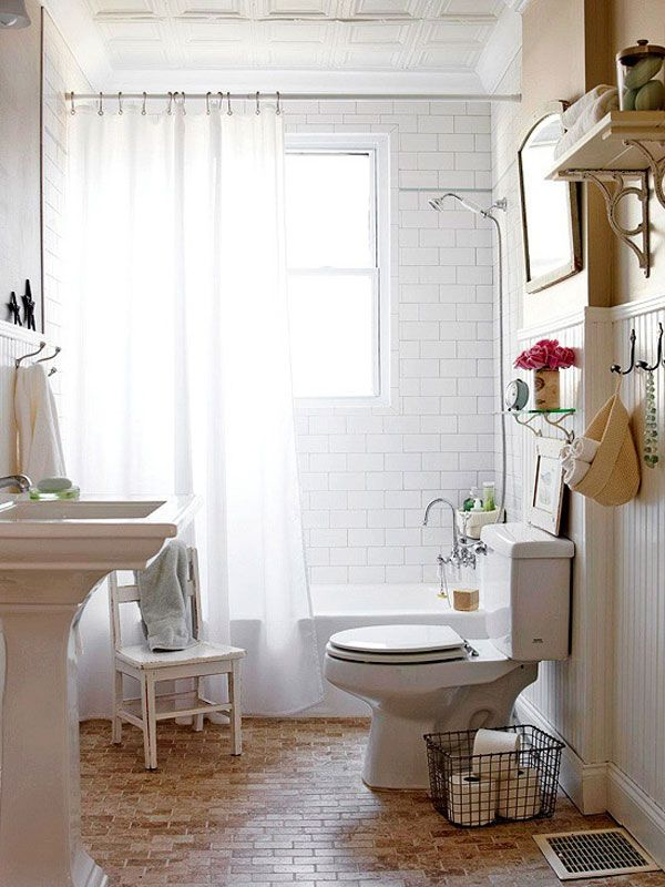 bathroom - White-painted tin ceiling tiles. White subway tile and beaded board. Beige tiles grouted in gray mimic brick and add warmth to the floor.