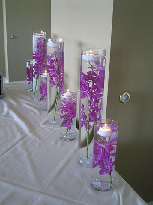 "lavender wedding ideas | Related Posts for "" purple wedding decorations ideas ""..This could be a very idea for any wedding!! You could use any long stemmed flowers to match your wedding colours..and use coloured beads on the bottom and or use food colouring to change the colour of the water."