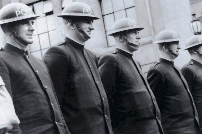 Anti-shrapnel steel helmets worn by police during World War II.