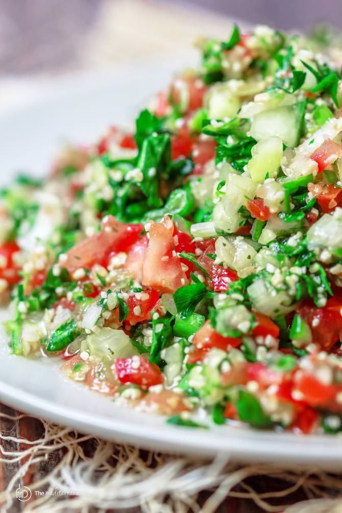 Traditional tabouli salad recipe with parsley, mint, bulgur wheat, finely chopped vegetables and a zesty dressing. Recipe with step-by-step photos.