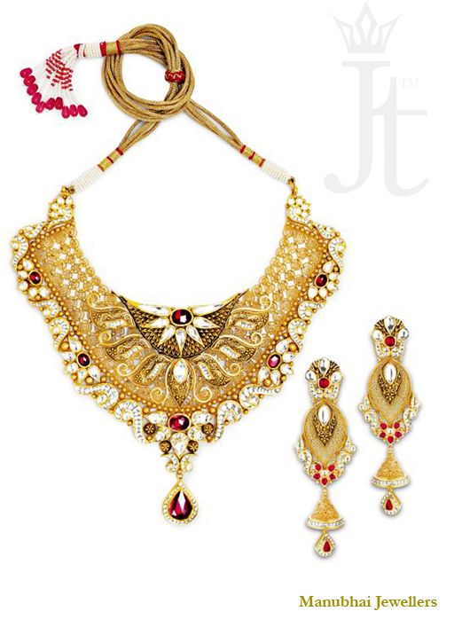Traditional 22K #gold #necklace with red and white kundan stones and delicate engraving work. #Bridal #jewellery by Manubhai Jewellers.