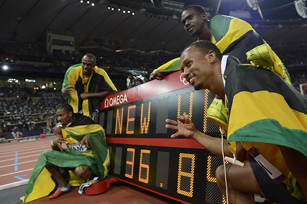 AUGUST 11: SEE U -- Jamaica's Usain Bolt took off from American Ryan Bailey in the anchor leg of the men's 4x100-metre relay at the London Olympics. Bolt capped a world record-breaking race for the Jamaicans as he completed a sweep of the sprint events (100, 200, 4x100) for the second consecutive Games. Canada appeared to have taken the bronze medal before judges ruled one of its runners had stepped out of his lane. (Photo by Adrian Dennis/Getty Images)