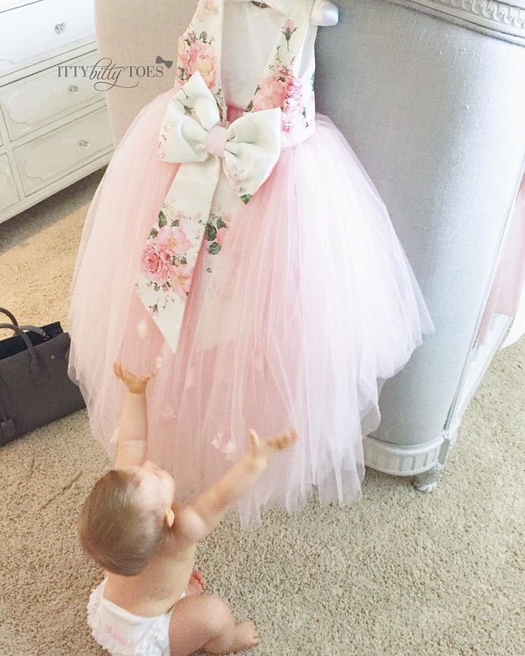 "We're in love with baby Sienna and her new Lili Dress!!   To order her dress go to: ittybittytoes.com Search ""Lili"""