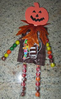 What you need: *Snack size bags of M&M's, Skittles, or whatever candy you prefer *Sixlets candy *Popsicle sticks *Pumpkin foam kit or Styrofoam pumpkins *Hot glue gun *Fall leaves or garland *Hole punch or scissors