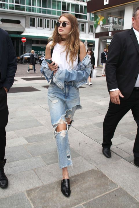 In a RE/DONE | Hanes muscle tee, denim jacket, destroyed high-waisted jeans with…