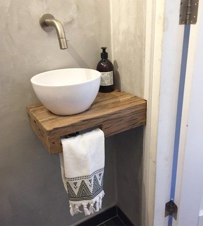 Small sink area with slot for towel