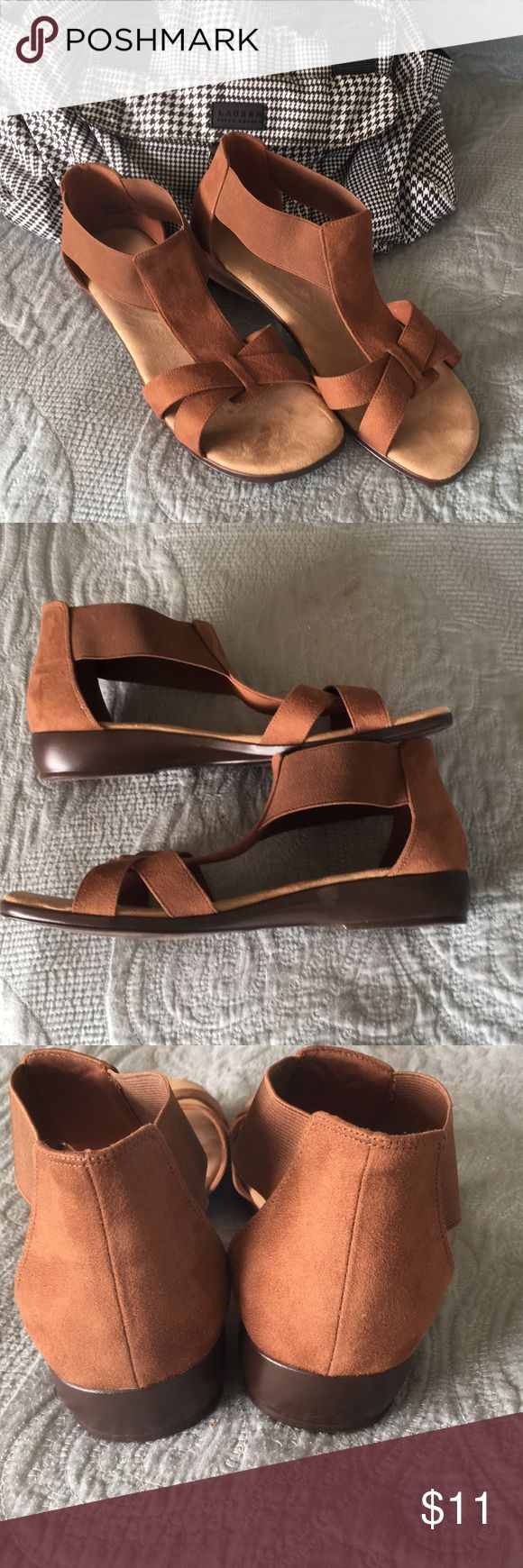 Cute Sandals Sz 10W Brown faux suede. Worn 1 time extremely comfortable but I ended up not caring for the elastic My Loss your Gain 🌞. Approx 1 inch heel, slip on style, padded foot bed. Flattering on feet with a gladiator vibe! I have other 10W in my closet make a bundle and I will offer a nice $ 💋 Comfort Plus Shoes Sandals