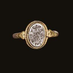 A VISIGOTHIC GOLD AND SILVER FINGER RING  CIRCA 7TH CENTURY A.D.