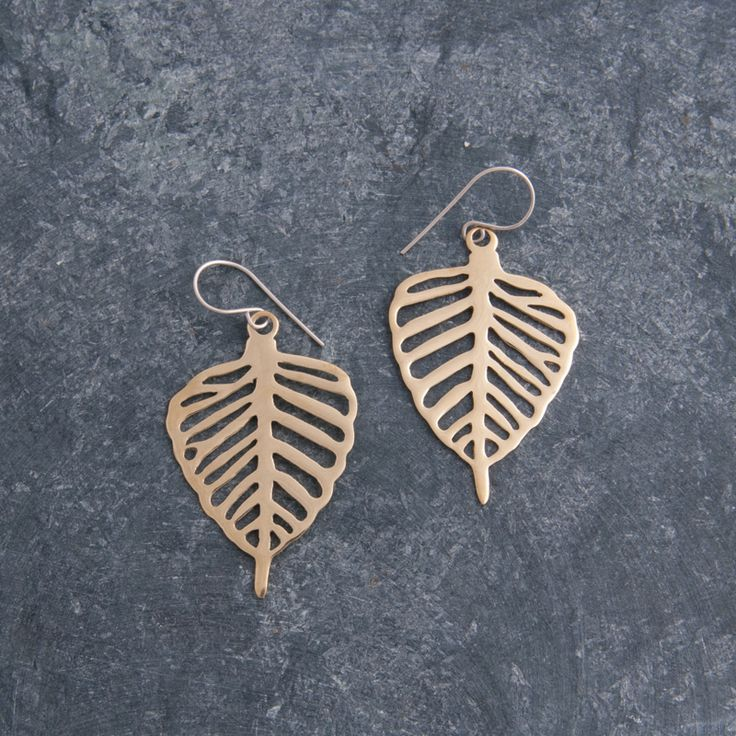 Fair trade Bodhi Leaf Earrings crafted from recycled bombshell casings in Cambodia. Available at Shop Kind.
