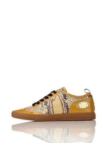 it.buyvip.com  Sneaker con stampa rettile e applicazioni in vernice. Targhetta in metallo dorato con logo su un lato. Soletta removibile.