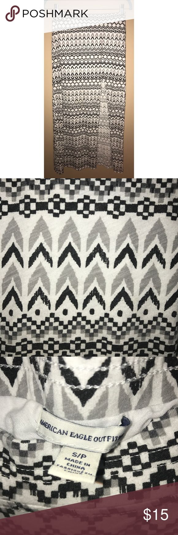 American Eagle Tribal Print Maxi Skirt American Eagle Outfitters Tribal Print Maxi Skirt. Size Small. Black/White/Grey. Side slit, attached white slip underneath. Materials: 60% Cotton 40% Polyester. Great Condition! American Eagle Outfitters Skirts Maxi