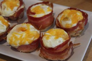 This sort of redefines the term 'bacon and eggs for breakfast'. Each egg muffin is wrapped with one piece of bacon, and baked in muffin tins. This makes...