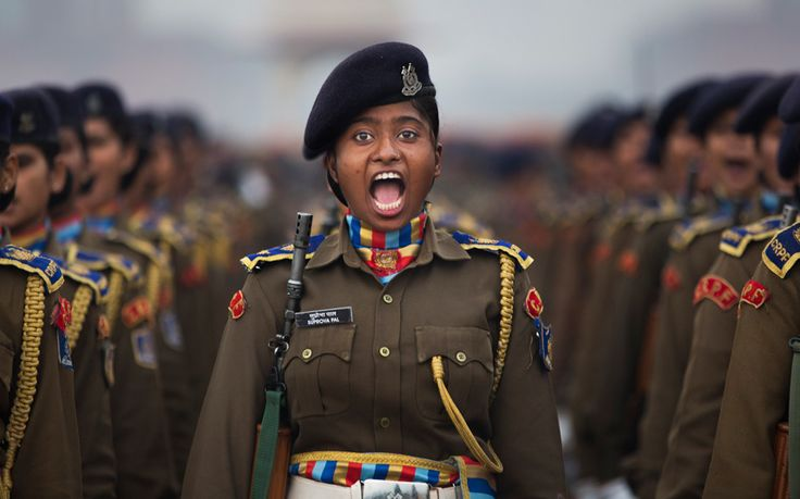 An officer from the Indian Central Reserve Police Force shouts orders during preparations for the forthcoming Republic Day parade, near the Presidential Palace in New Delhi. India marks Republic Day on January 26.