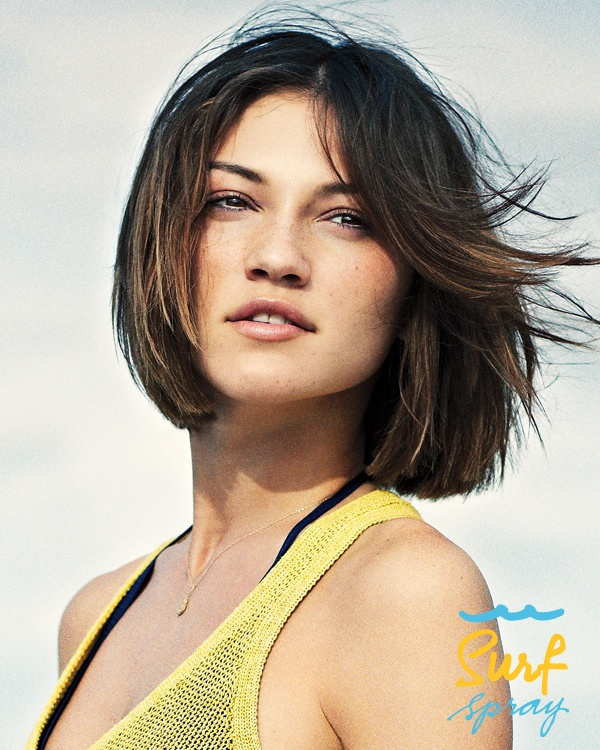 Straight dark brown bob haircut with side swept bangs and highlights hairstyle