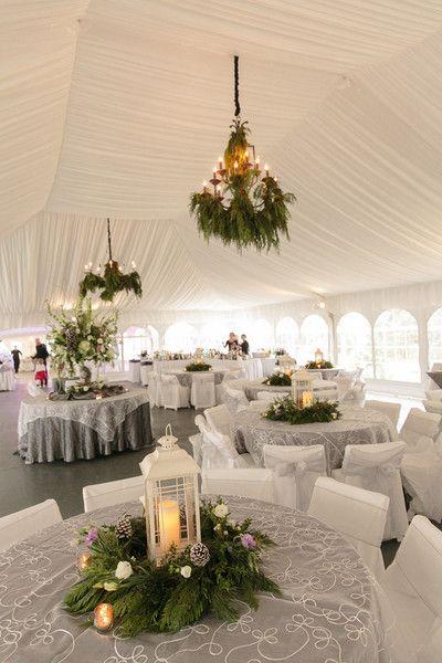 Winter wedding reception decor with a beautiful white draped tent and winter greenery {Arte De Vie}