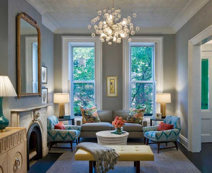 Grey Sofa Living Room Design Ideas with modern ceiling chandeliers and grey rug on the floor also cream table
