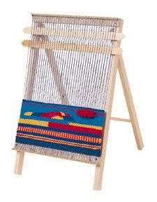 This is a weaving loom.  What fun.