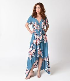 Simple and sweet seventies style! Presenting a beautiful teal blue dress in a glorious pink floral throughout. Crafted in a lightweight textured knit blend, the short sleeves complement the faux wrap v-neckline and combines with an elasticized waist compl