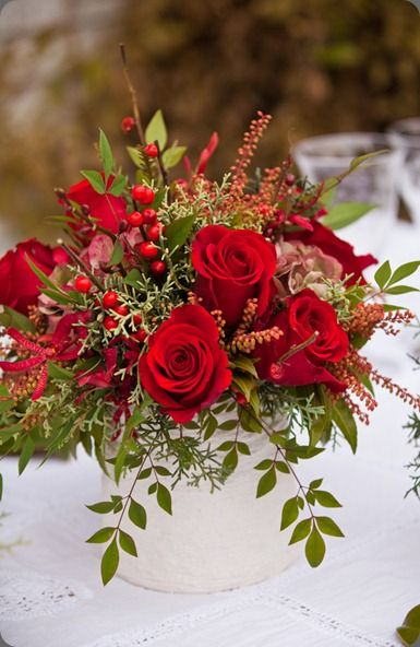 Red rose/berry/evergreens flower arrangement