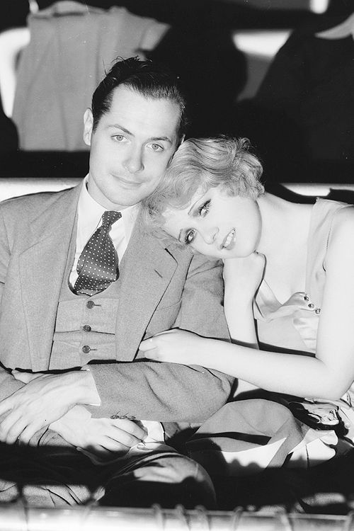 "Robert Montgomery attends a screening with actress Anita Page. The two co-starred in three movies in 1930 - ""War Nurse"", ""Our Blushing Brides"" and ""Free and Easy"", photographed by Clarence Sinclair Bull, 1930."