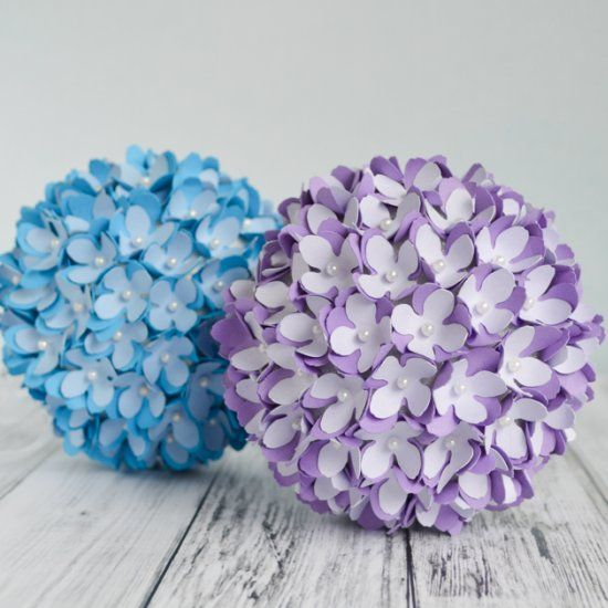 Learn how to make beautiful paper flower pomanders that are perfect for a DIY wedding or home decor.